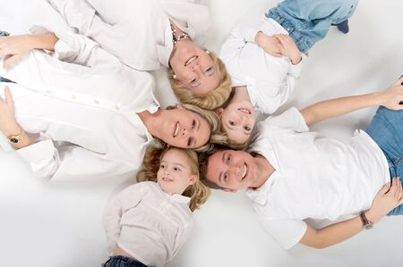 Heads of family members close together forming a circle Stock Photo - 9603057