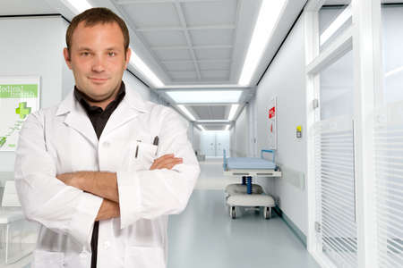 Young doctor standing by a hospital corridor   Stock Photo - 9602948