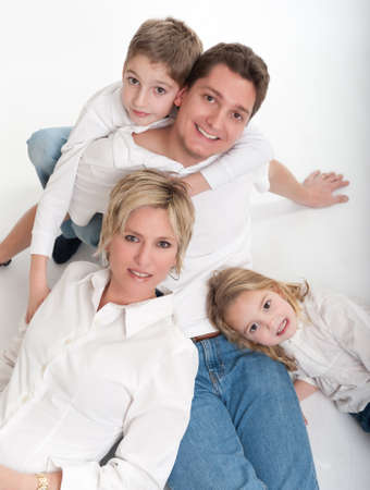 Man and wife posing on the floor with a girl and a boy   Stock Photo - 9603036