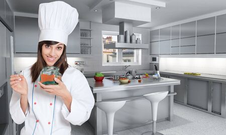 Young female chef with an open red spice pot   Stock Photo - 9603073