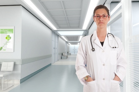 Grave looking female doctor in a hospital interior Stock Photo - 9676548