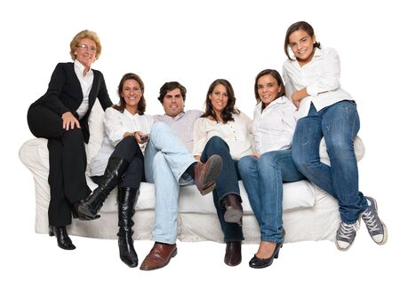 man couch:   Isolated group of family members sitting on a sofa watching TV