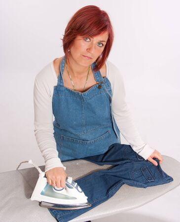 Woman ironing with a serious expression   photo