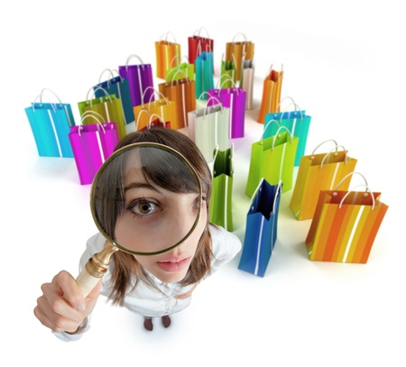 Young woman with magnifying glass with lots of shopping bags   photo