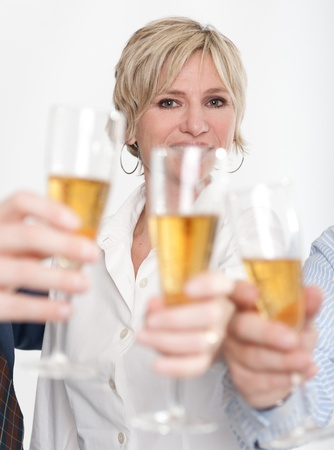 Woman toasting with other people   Stock Photo - 9948136