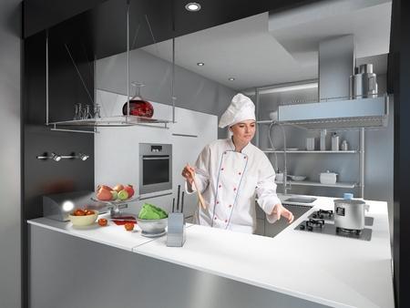 cocinas industriales:  Joven con uniforme de cocineros y toque en una cocina industrial moderna