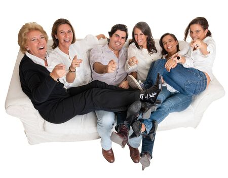 Isolated family group pointing at the camera happily laughing    photo