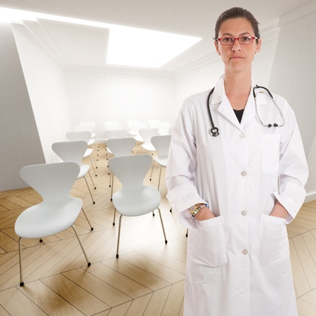 operation room:   Serious female doctor in a conference room
