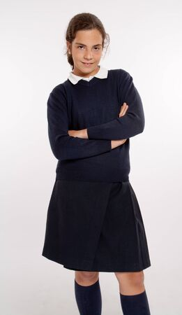 uniform student:  Standing schoolgirl with the typical navy blue uniform  Stock Photo