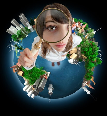 magnifying glass:   Young woman with a magnifying glass standing on the Earth