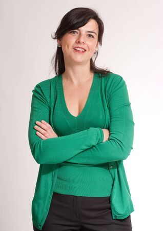 thirty:  Portrait of a cheerful brunette dressed in green  Stock Photo