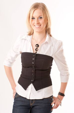 Cute young blond girl with a shirt and a vest