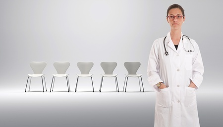 Female doctor with a row of white chairs at the background   photo