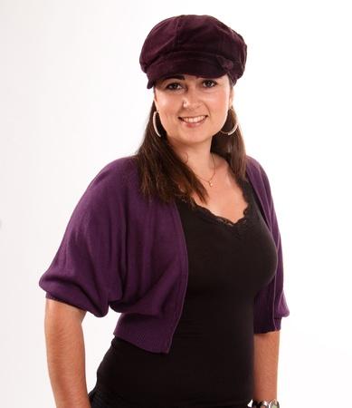 headgear:  Portrait of a brunette wearing a purple cap  Stock Photo