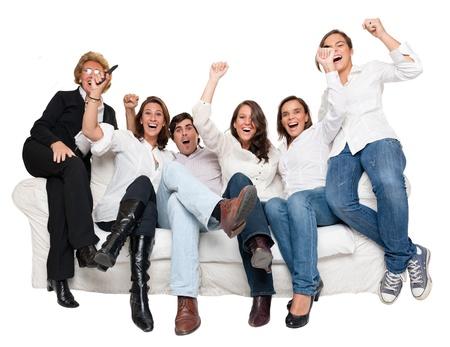 family movies: Grupo aislado de miembros de la familia se sienta como en casa animando Foto de archivo