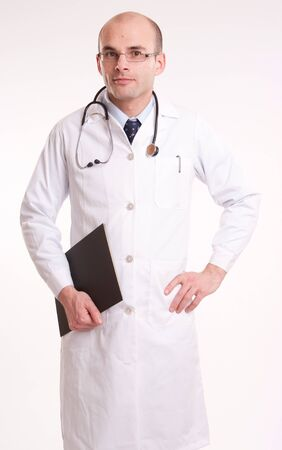 Doctor holding a black file against a neutral background Stock Photo - 10441889