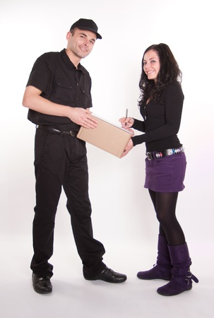 Messenger delivering a parcel to an attractive brunette  Stock Photo - 10441862