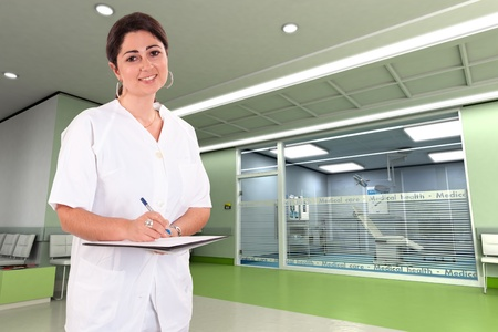 administration:  Female medical professional in a modern clinic