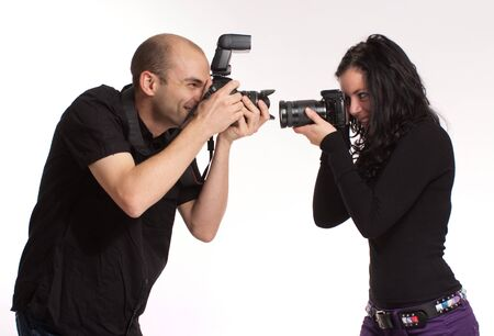 joking:  Couple taking pictures of each other  Stock Photo