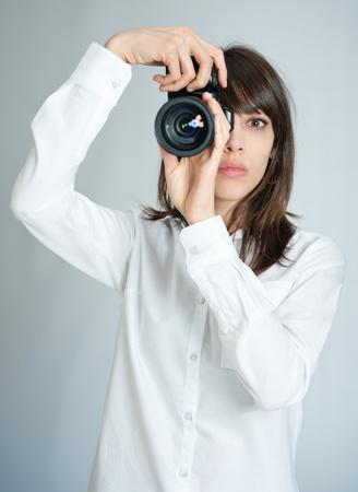 Female photographer adjusting her camera  photo