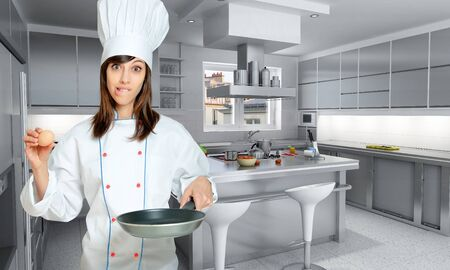 Young woman in chef  attire with funny expression with an egg and a frying pan   photo