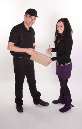 Messenger delivering a parcel to an attractive brunette  Stock Photo - 10601741