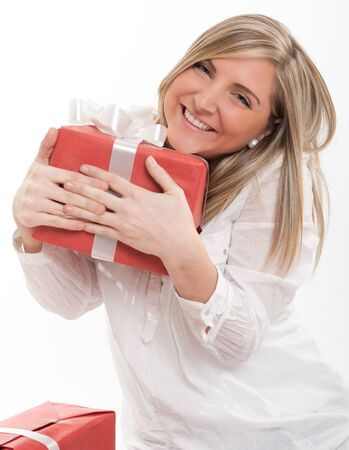 grateful: Happy blonde young woman holding a present Stock Photo