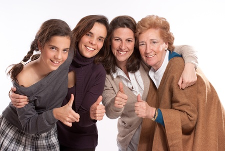 age 60:  Isolated image of for women of different generations happy and with thumbs up