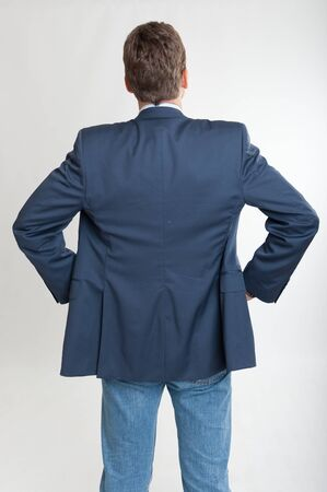hands on hips:  Rear view of a man with hands on his hips