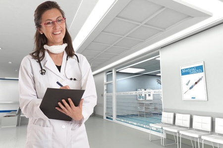 hospital corridor:    Cheerful female doctor in a hospital interior   Stock Photo