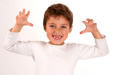 Portrait of a cute young boy with a scary gesture  photo
