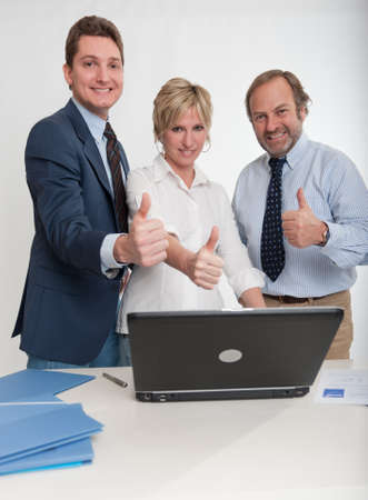 Three business people doing the ok sign  Stock Photo - 10645240