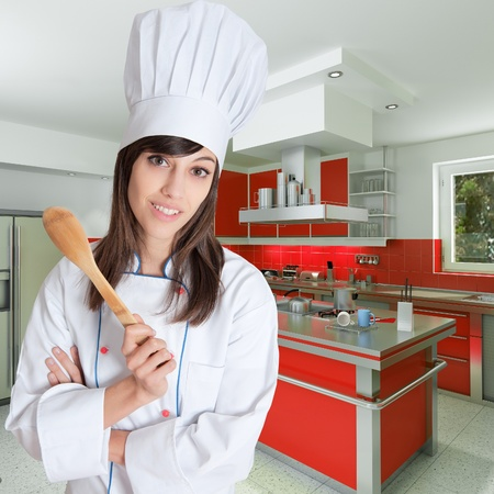 toque:  Young female chef holding a wooden spoon in a beautiful kitchen