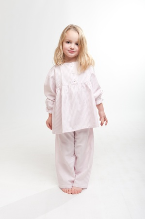 nightdress:  Cute little blonde girl in her pajamas  Stock Photo