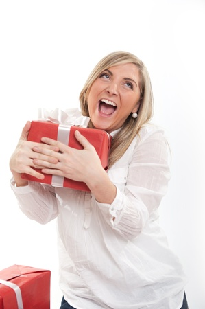 18 19: Happy blonde young woman holding a present Stock Photo