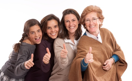 generation:  Isolated image of for women of different generations happy and with thumbs up