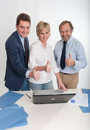 Three business people doing the ok sign  photo