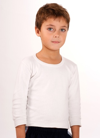 blond boy:  Portrait of a cute young boy with beautiful green eyes