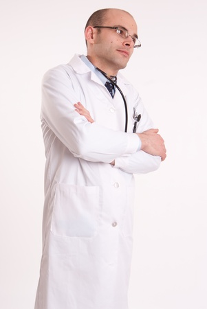Doctor with his arms crossed and a serious expression Stock Photo - 10769159
