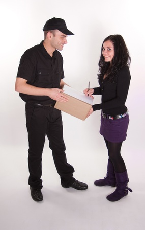 Messenger delivering a parcel to an attractive brunette Stock Photo - 10769154