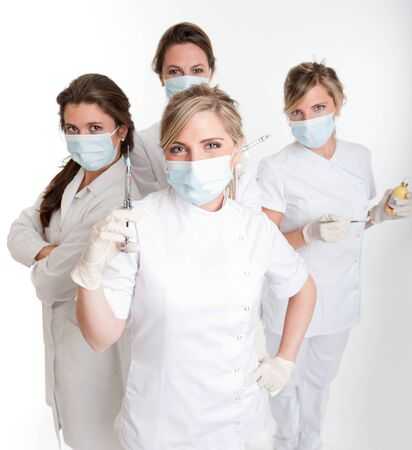 latex girl:     Four female dentists posing with masks and equipment   Stock Photo