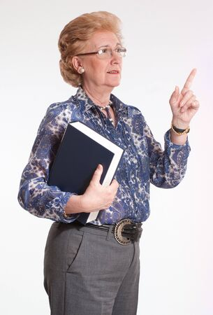 Portrait of a smiling mature teacher in the middle of an explanation  photo