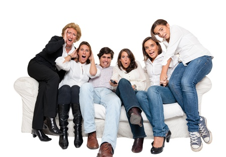 A group of family members sitting at home watching nervously TV   photo