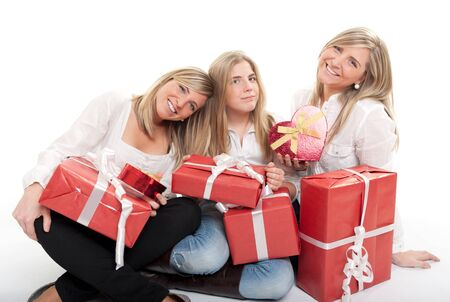18 19:  Three young sisters surrounded by gift boxes, some of them heart shaped  Stock Photo