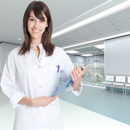 Reassuring medical professional with a folder  in a modern clinic  Stock Photo - 10893731
