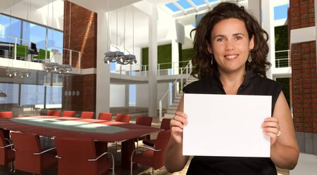 Woman presenting a blank sign in a luxurious modern office interior   Stock Photo - 10903994