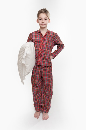cushion:   Little boy in pyjamas holding a pillow