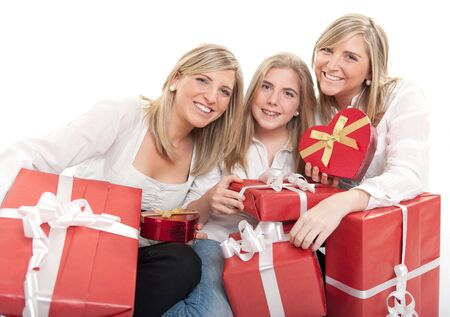Three young sisters surrounded by gift boxes, some of them heart shaped  photo
