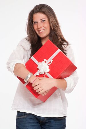 red gift box:  Cheerful cute young woman holding a red gift box