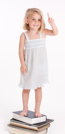 nighttimes:   Little girl in her nightgown asking for one more minute   Stock Photo